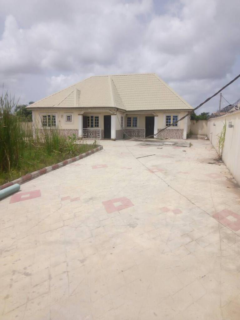 Detach bungalow, with 3 bedroom, and 2 bedroom flat
